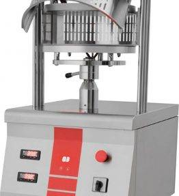 Pizza shaping machine